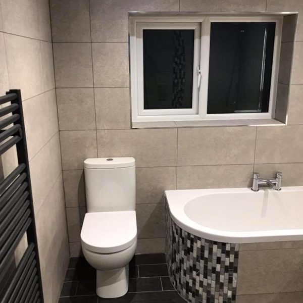 Monochrome Bathroom with Mosaic Tiling Features on the Bath