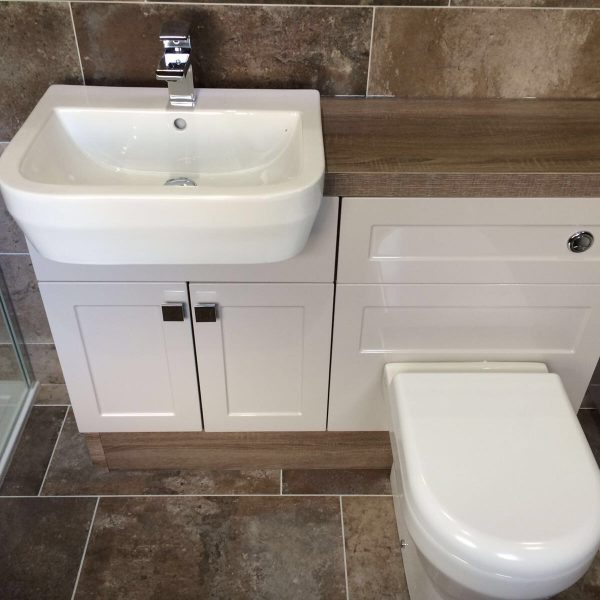 Family Bathroom white suite and brown tiles