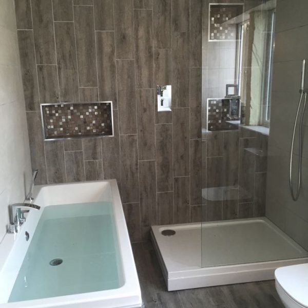 Grey and white bathroom with Filled Bath