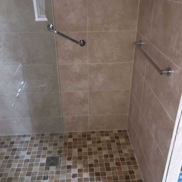 Easy access bathroom with handles in shower