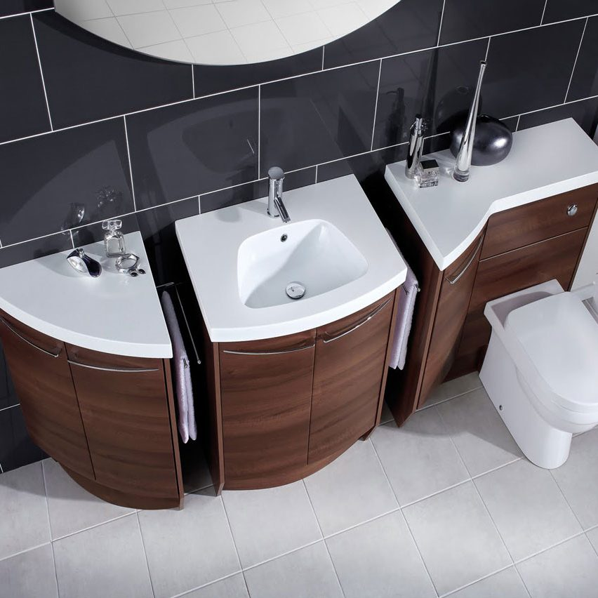 Attached Sink and Toilet with Dark Tiled Walls