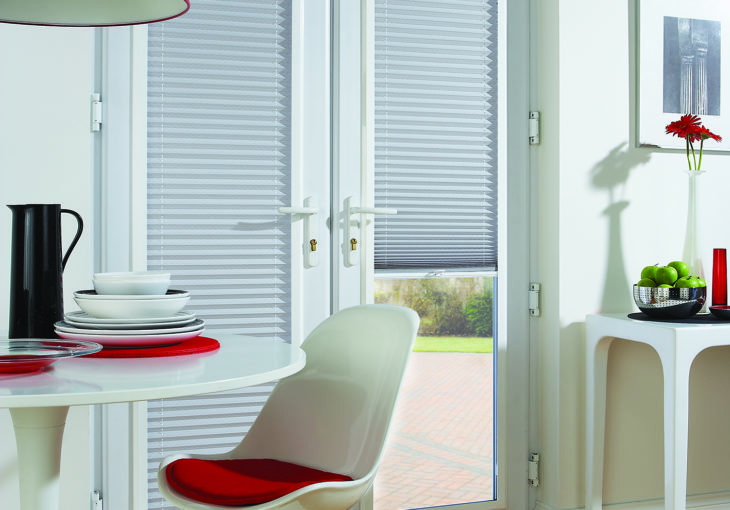 Pleated Madrid Chrome perfect fit blinds in a dining room