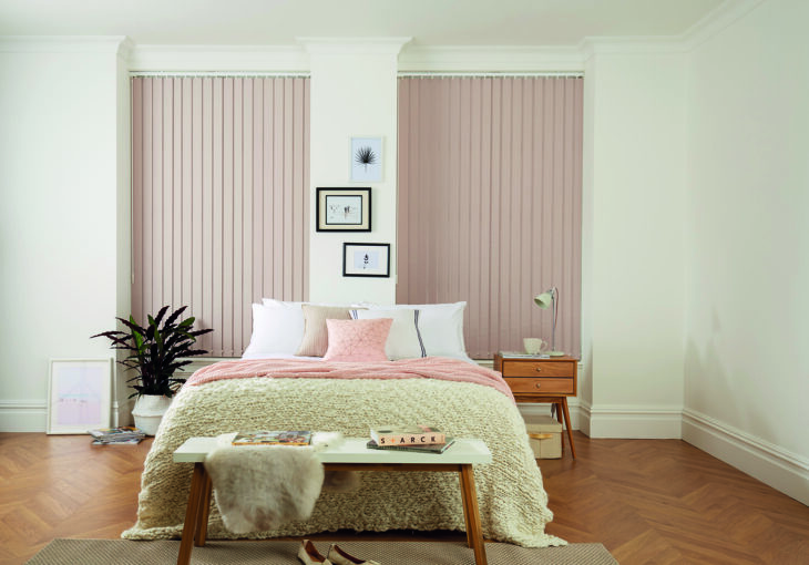 Bedroom with vertical blinds