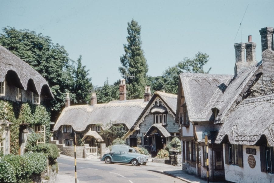 Small village with a number of thatched cottages
