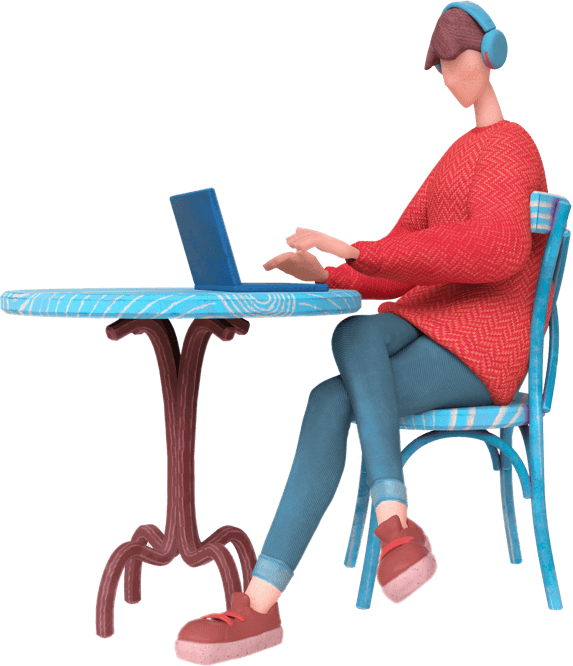 A person sat at a table working on a laptop